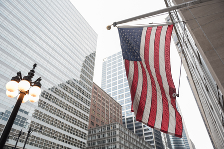 National colors situating in front of tall buildings