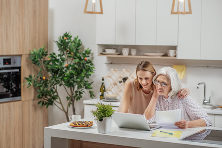Joyful family using laptop at home
