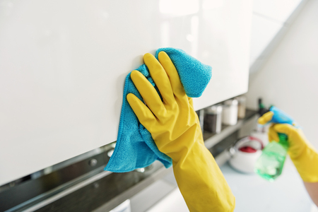 Active cleaning at kitchen zone Stock Photo