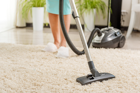 carpet clean: Woman cleaning room with vacuum cleaner Stock Photo
