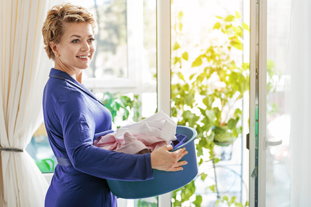 Well-groomed female person at home Stock Photo