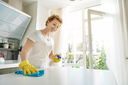 Happy female person doing householding
