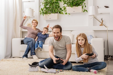 Parent and child playing video game console