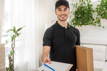 Confident man with parcel in room