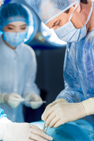Attentive medical person at operation