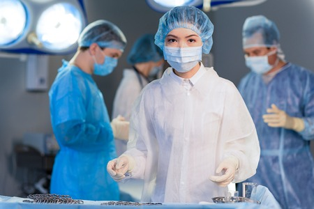Confident doctor in operating theatre Stock Photo