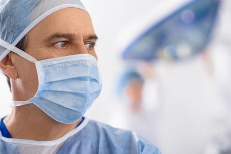 curiously: Male medical person glancing curiously
