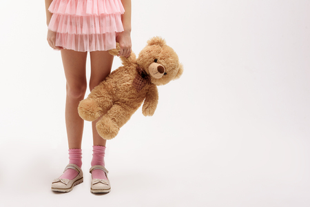 Little female child keeping teddy bear