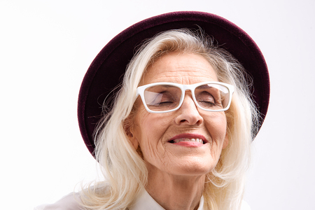 Happy smiling mature woman wearing glasses Stock Photo