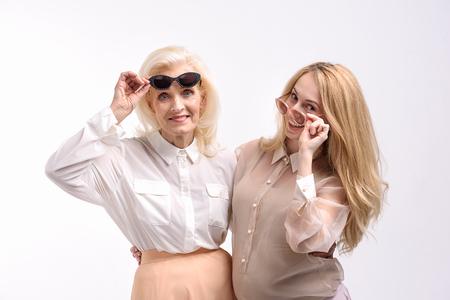 Happy smiling women in sunny eyewear Stock Photo