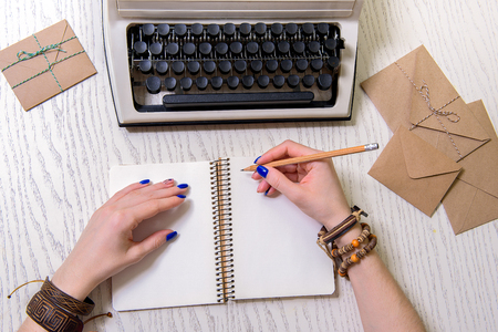 retro woman: Woman using pencil for writing