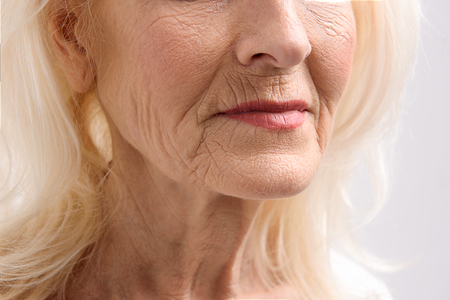 Mature female person with wrinkles Imagens
