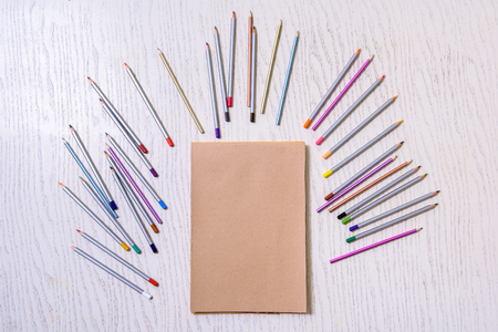Various colored pencils at desk Stock Photo