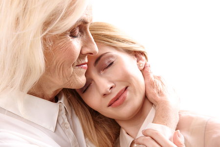 necking: Old mother necking her daughter Stock Photo