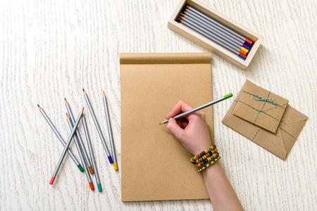 Woman keeping crayon with green rob Stock Photo