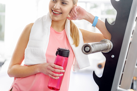Glad female reclining on fitness tool Imagens