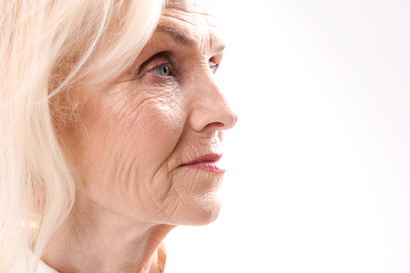 Serious old woman glancing ahead