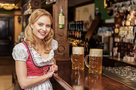 Cheerful female working at boozer
