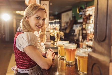 Outgoing woman having job in alehouse Stock Photo