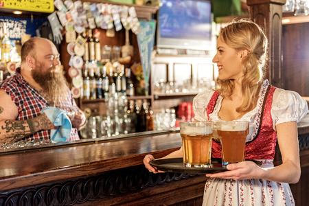 Outgoing young female speaking with man in bar