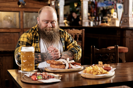 Desire obese male tasting meals in boozer Stock Photo