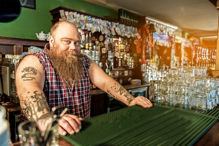 Cheerful fat tapster working in boozer Stock Photo