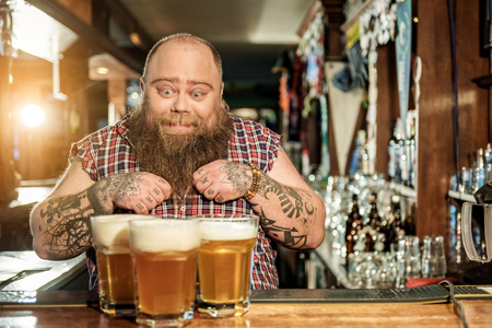 Cheerful fat man wants drink alcohol Stock Photo