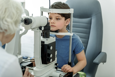 Checking vision of little kid Stock Photo - 77187284