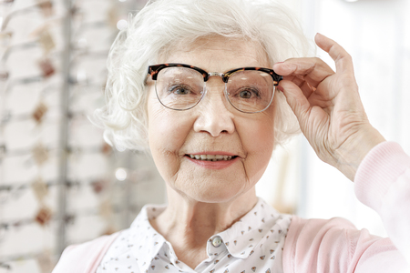 Joyful senior woman in optic store