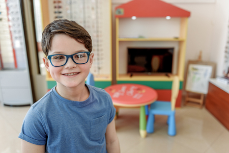 affable: Happy smiling glance of child in spectacles