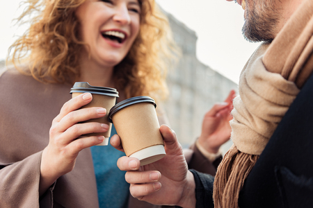 Cheerful man and woman drinking hot beverage Stock Photo