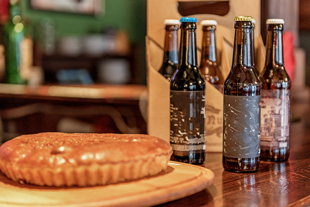 beer pump: Alcohol beverage and cake situating on counter Stock Photo