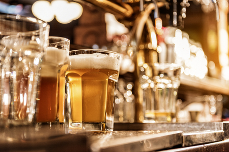 Glass of cold alcohol beverage on desk