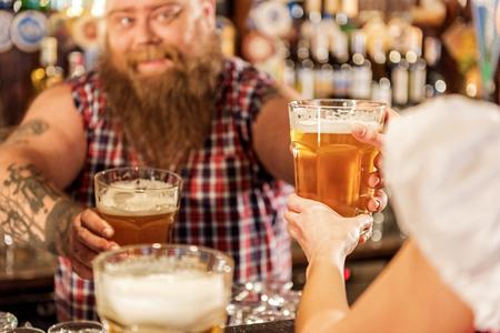 Bearded man giving drinks to waitress Stock Photo