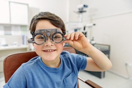 Joyful small kid in eyewear