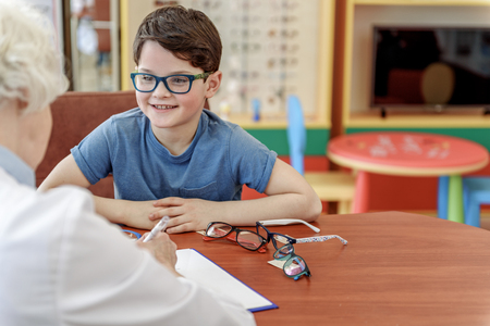 hilarious: Hilarious little boy in eyewear Stock Photo