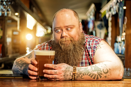 Cheerful man wanting to taste ale Stock Photo