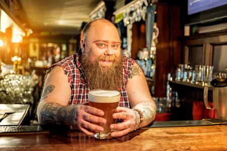 Happy fat man tasting alcohol beverage Stock Photo