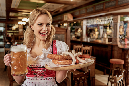 Glad woman bearing order to table