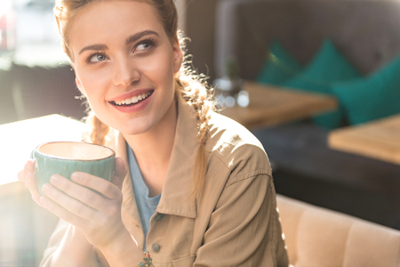 dreaminess: Thoughtful woman drinking cup of coffee