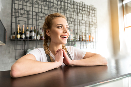 Cheerful woman working in confectionary shop Stock Photo