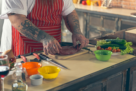 Fat man preparing tasty food Stock Photo