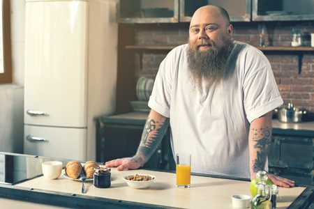 fatso: Happy male fatso prefers healthy eating Stock Photo