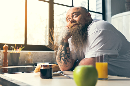 Male fatso dreaming about food Stock Photo