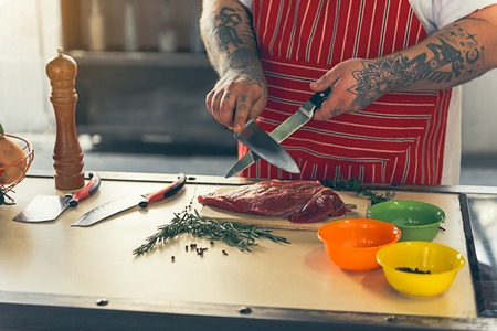 Chef preparing knife before cooking Stock Photo