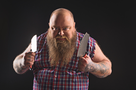 Fat guy with knife expressing his aggression