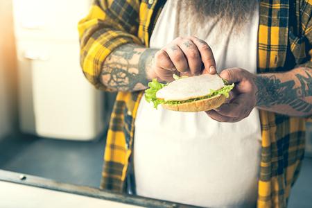 fatso: Male fatso preparing unhealthy food