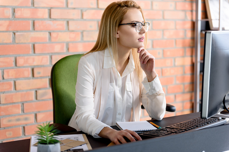 Smart woman busy at her job Stock Photo