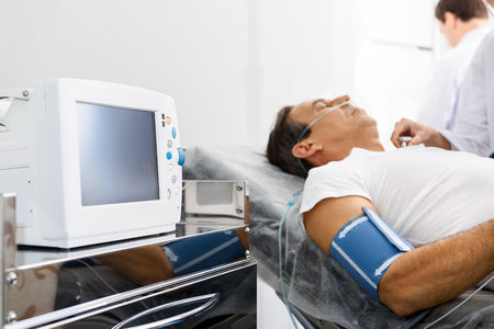 Medical device measuring pressure of client Stock Photo
