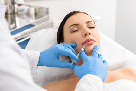 Sure girl tolerating anguish injection in lips